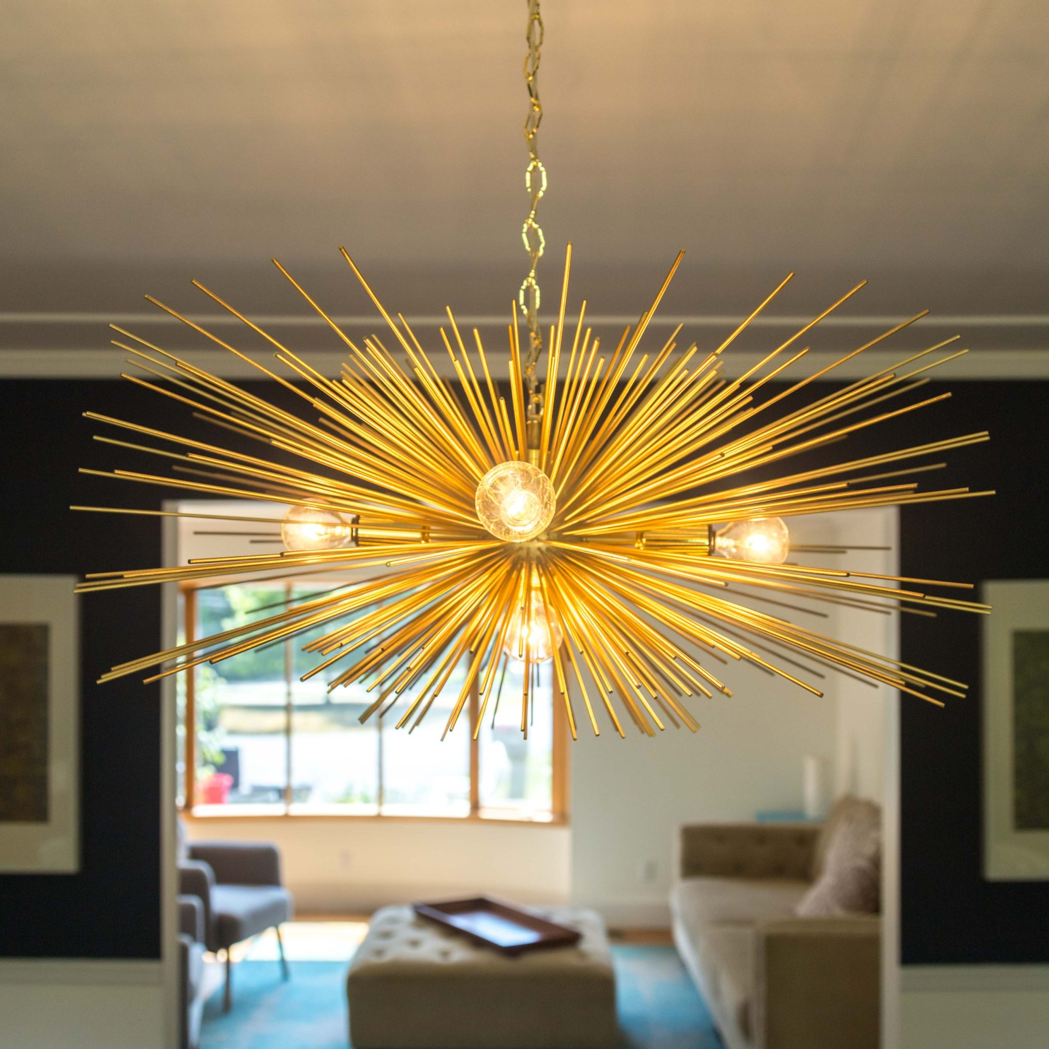 our new dining room on allweareblog.com | dining room light | gold light | brass light | chandelier