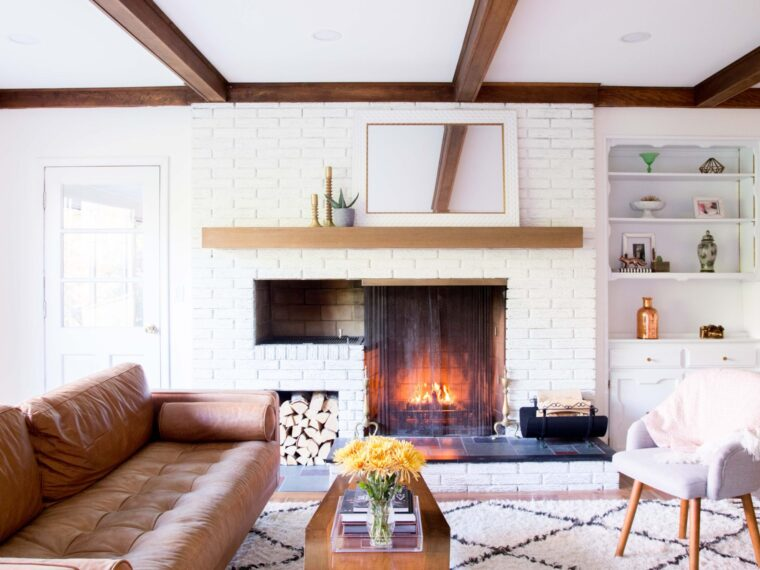 midcentury modern family room | natural fireplace | home renovation | fixer upper | shag rug | open family room | cozy family room | gallery wall around tv | our new family room on allwereblog.com