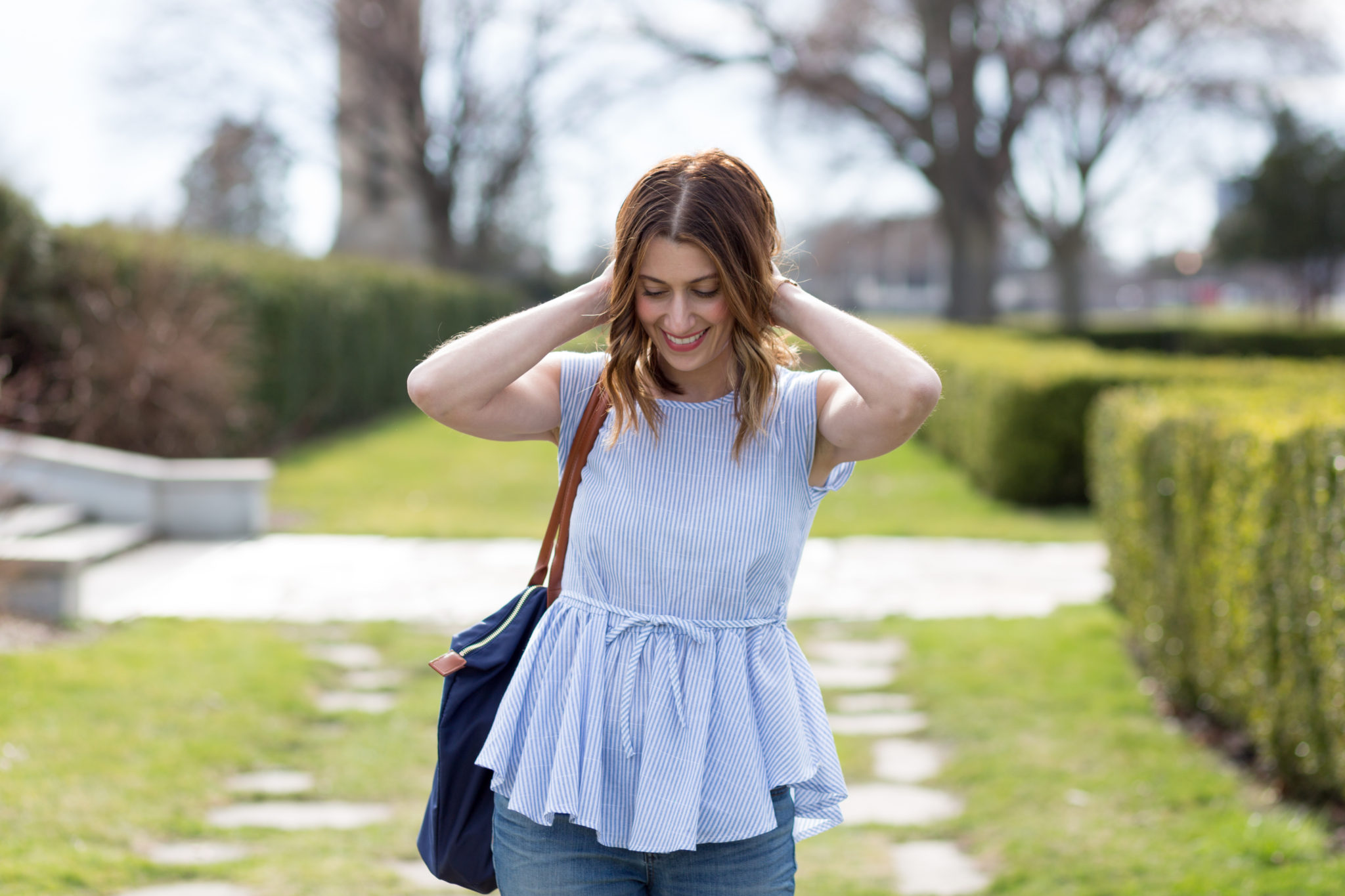 Cute tops for spring | Peplum style tops | Ruffle tops | How to style clogs for spring | SheIn Blue Vertical Striped Self Tie Ruffle Hem Blouse on allweareblog.com