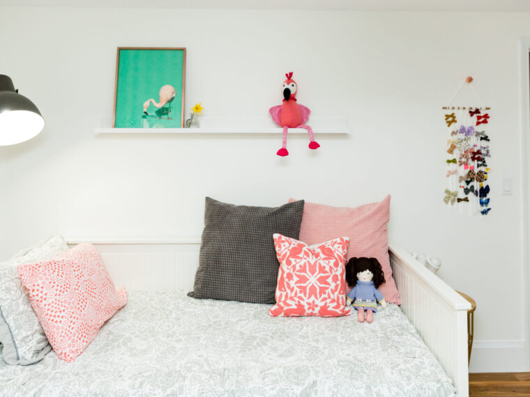 Toddler girl bedroom | how to decorate a bedroom for a toddler girl | IKEA HEMNES daybed | chalkboard wall | moving your child from a crib to a bed on allweareblog.com