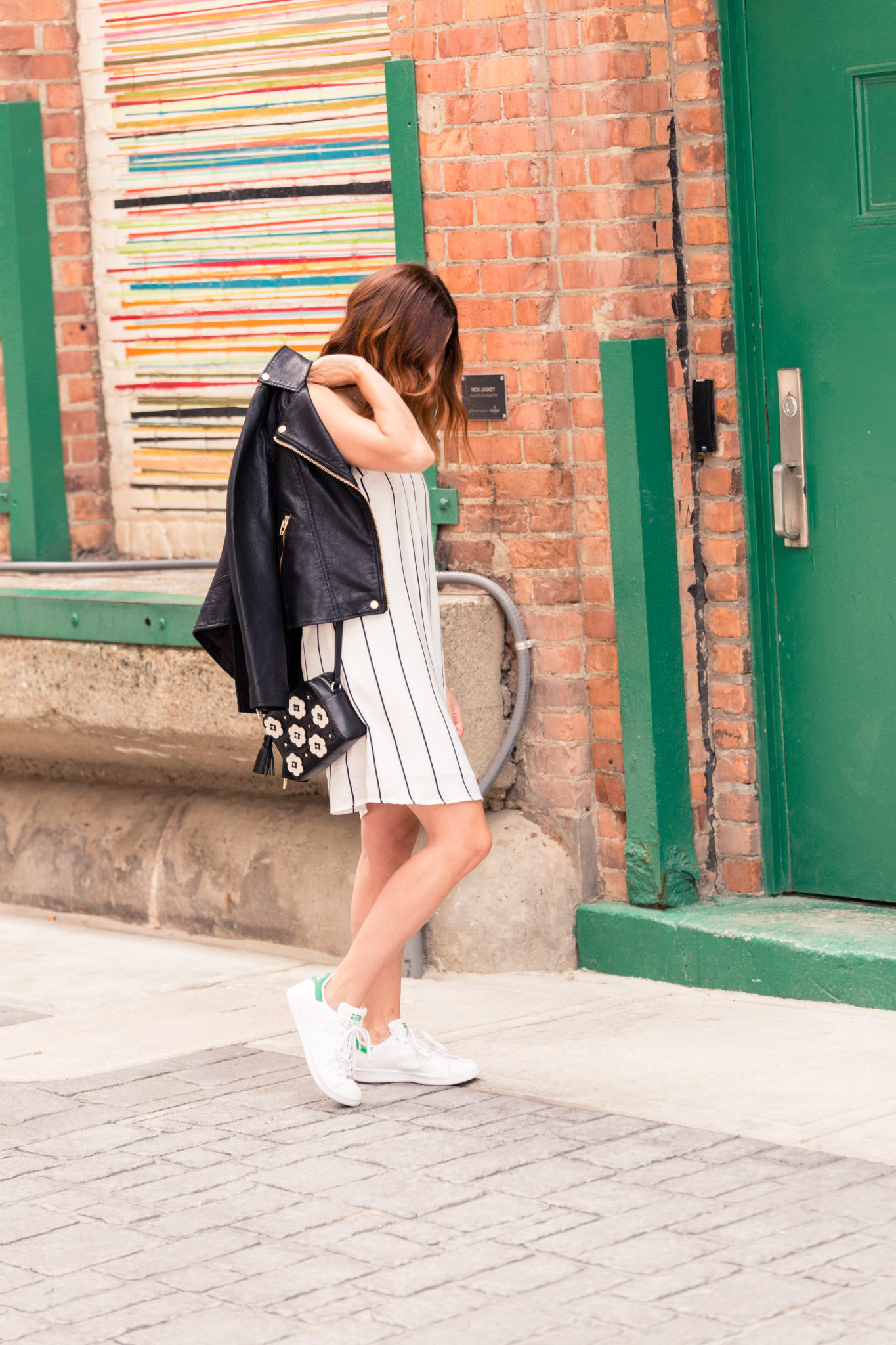 how to wear a dress and sneakers   Layering a leather moto jacket over a dress   slip dress style   the best moto jacket of the nordstrom anniversary sale 2017 under $100 on allweareblog.com