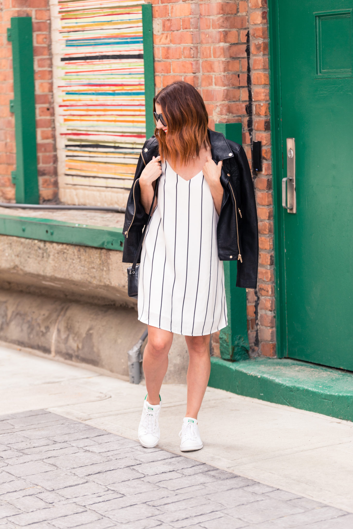 how to wear a dress and sneakers | Layering a leather moto jacket over a dress | slip dress style | the best moto jacket of the nordstrom anniversary sale 2017 under $100 on allweareblog.com